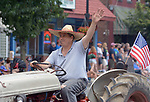 A member of the Saugerties Vintage Tractor Club, seen in the Independence Day Parade in Village of Saugerties, NY, on Tuesday, July 4, 2017. Photo by Jim Peppler. Copyright/Jim Peppler-2017.