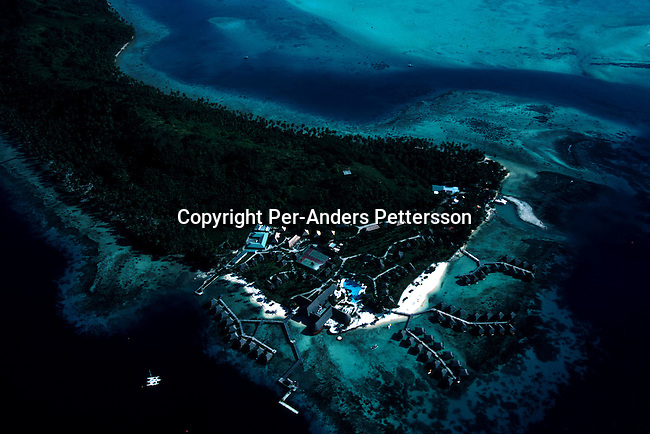 An aerial view of a resort hotel on April 18, 1997 on Bora Bora, a paradise island in French Polynesia. The Island is a playground for rich tourists and Hollywood stars as it provides total security and privacy. Most local people live of the tourism industry usually working in one of the luxury resorts. .(Photo: Per-Anders Pettersson/ Getty Images)