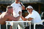 TWO MEN PREPARE TO ARM WRESTLE AT BAR IN MEXICO