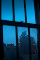 Buildings and water towers seen through window
