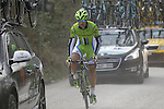 Oscar Gatto (ITA) Cannondale caught amongst the team cars behind the peloton tackles the 1st sector of strade at Pian del Lago during the 2014 Strade Bianche race over the white dusty gravel roads of Tuscany running from San Gimignano to Siena, Italy. 8th March 2014.<br /> Picture: Eoin Clarke www.newsfile.ie