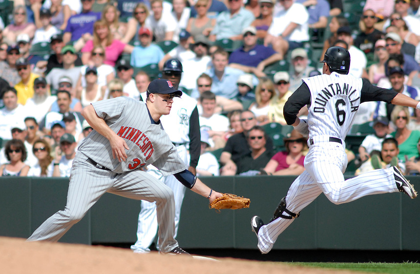 Colorado Rockies 2nd baseman Omar Quintanilla is a half step behind the throw to Minnesota Twins 1st baseman Justin Morneau and is called out. The Rockies defeated the Twins 6-2 at Coors Field in Denver, Colorado on May 18, 2008. FOR EDITORIAL USE ONLY. FOR EDITORIAL USE ONLY