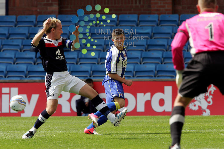 Killies Matthew Kennedy puts in this cross but Dundee's  skipper Gary Irvine does enough to put it off...SPL match between  Kilmarnock & Dundee at Rugby Park Saturday 4 August 2012 Picture: Universal News & Sport (Scotland)