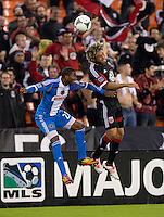Nick DeLeon (18) of D.C. United goes up for a header with Raymon Gaddis (28) of the Philadelphia Union during a Major League Soccer game at RFK Stadium in Washington, DC. D.C. United tied the Philadelphia Union, 1-1.