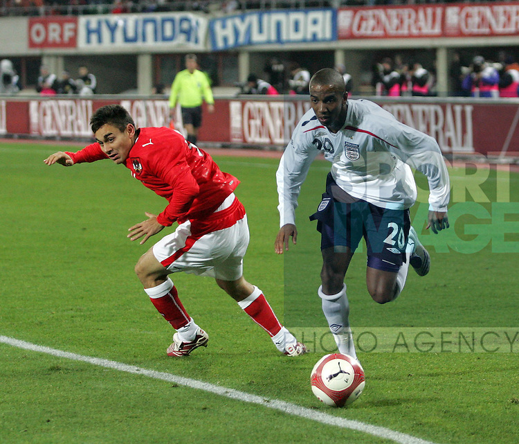 England's Ashley Young goes past Austria's Roman Kienast