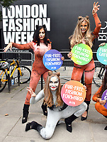 LONDON, ENGLAND - SEPTEMBER 14: PETA cats pounce on London Fashion Week to celebrate Fur-Free Catwalk.  Following the announcement that this season's London Fashion Week will not showcase any animal fur, a gang of PETA cats strut outside the event to celebrate the fur-free catwalks. <br /> CAP/JOR<br /> &copy;JOR/Capital Pictures