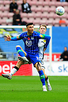 Kieffer Moore of Wigan Athletic vies for possession with George Byers of Swansea City during the Sky Bet Championship match between Wigan Athletic and Swansea City at The DW Stadium in Wigan, England, UK. Saturday 2 November 2019