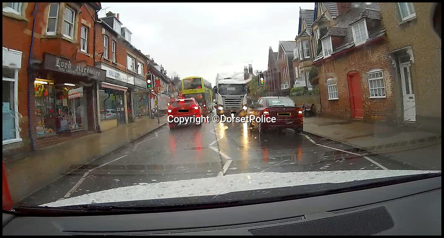BNPS.co.uk (01202 558833)<br /> Pic:  DorsetPolice/BNPS<br /> <br /> A still from dashcam footage inside a taxi which shows the traffic lights turning to red, the lorry driven by Dean Phoenix, and the car illegally parked (on the right).<br /> <br /> A lorry driver who sarcastically clapped a motorist moments before he knocked down and killed a young boy on a pedestrian crossing was today cleared of causing death by dangerous driving.<br /> <br /> Dean Phoenix admitted he made a mistake by failing to see a red light at the crossing to allow three-year-old Jaiden Mangan and his family walk across.<br /> <br /> Phoenix, 44, pulled away without seeing them and collided with Jaiden, who suffered fatal chest and abdominal injuries.<br /> <br /> A court heard that the Phoenix had been distracted at the time because he was 'sarcastically clapping' another motorist just as he drove off.