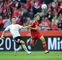 Fussball 1. Bundesliga :  Saison   2011/2012   Liga Total Cup  20.07.2011 FSV Mainz 05 - FC Bayern Muenchen Elkin Soto (li, 1. FSV Mainz 05) gegen Thomas Mueller (re, FC Bayern Muenchen)