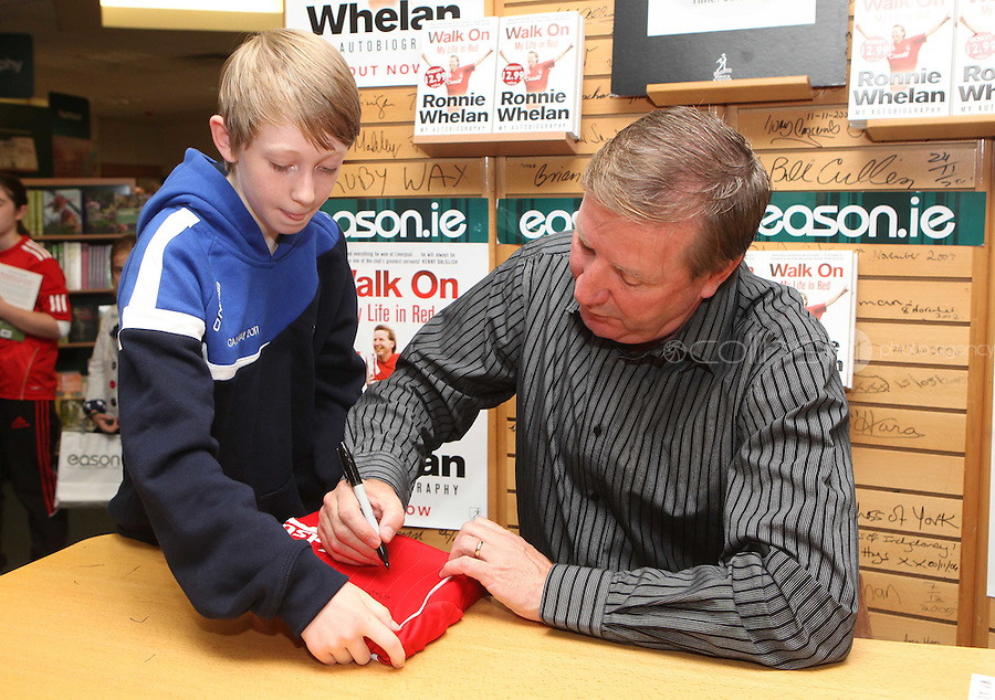 ***NO FEE PIC ***.10/09/2011.Eason Ireland's leading retailer of books , stationery, magazines & lots more hosted a book signing by former Liverpool & Irish international soccer player Ronnie Whelan..Pictured at Eason O' Connell street, Dublin is Ronnie Whelan &  Peter Harte (12) fro Glasnevin.signing copies of his new autobiography WALK ON for fans..Follow Eason on twitter- @easons..Photo: Collins