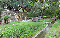 The acequia with irrigation systems, diverting water from the river to the farmland, and powering the gristmill, at the Mission San Jose, or Mission San Jose y San Miguel de Aguayo, a Spanish catholic colonial mission and church originally established in 1720 and completed in 1782, to spread Christianity among Native Americans, the largest of 4 missions in the San Antonio Missions National Historical Park, in San Antonio, Texas, USA. The complex was home to 350 Indians and had its own mill and granary. It was restored in the 1930s and again in 2011. It forms part of the San Antonio Missions UNESCO World Heritage Site. Picture by Manuel Cohen
