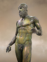 Torso of the Riace bronze Greek statue B cast about 460 - 450 BC. statue B was probably sculpted by Phidias. There is a sense of movement in the statues their legs being bent as if they are about to take a step. Their heads are turned which accentuates a sense of anticipation as if they are looking for something. The anatomical detail is extraordinary which gives a startling realism to the statue and demonstarte the high level of skill of the Greek sculptors of this period. Museo Nazionale della Magna Grecia,  Reggio Calabria, Italy.