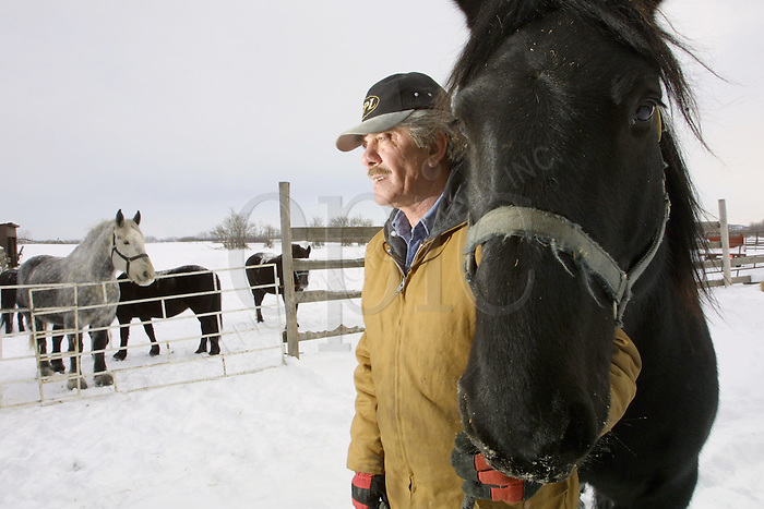 Horse owner Morris Presisniuk on January 26, 2003 with Queen on Mr. Presisiuks farm, northeast of Edmonton. John Ulan/Epic Photography Inc.