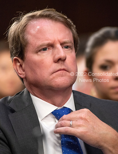 White House Counsel is Don McGahn adjusts his tie as he listens to the opening remarks as Judge Brett Kavanaugh testifies before the United States Senate Judiciary Committee on his nomination as Associate Justice of the US Supreme Court to replace the retiring Justice Anthony Kennedy on Capitol Hill in Washington, DC on Tuesday, September 4, 2018.<br /> Credit: Ron Sachs / CNP<br /> (RESTRICTION: NO New York or New Jersey Newspapers or newspapers within a 75 mile radius of New York City)