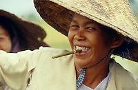 Rice planter having a Burmese-cigarette-break.