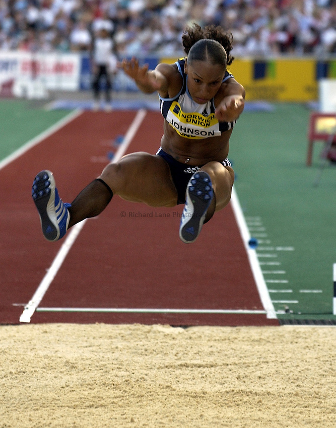 Photo. Henry Browne..Norwich Union London Grand Prix Athletics at Crystal Palace. 30/07/2004..Womens Long Jump..Jade Johnson reaching out to gain more distance.