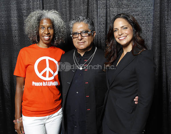 NEW ORLEANS, LA - JULY 4: Erica Ford, Deepak Chopra, and Soledad O'Brien backstage at the 2015 Essence Festival at the Ernest N. Morial Convention Center on July 4, 2015 in New Orleans, Louisiana. Credit: PGST/MediaPunch
