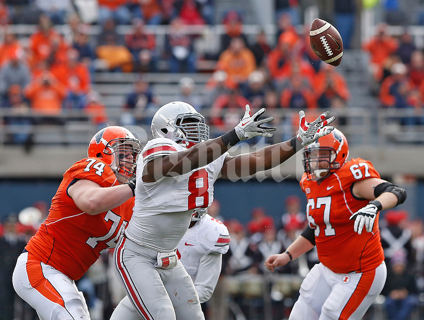 Ohio State Buckeyes defensive lineman Noah Spence (8) almost pulls down an interception by Illinois Fighting Illini quarterback Nathan Scheelhaase (2) at Memorial Stadium in Champaign, Illinois on November 16, 2013.  (Chris Russell/Dispatch Photo)
