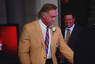 Canton, OH - August 6, 2016: Former NFL player Kevin Greene walks backstage after giving his speech at the Pro Football Hall of Fame Enshrinement Ceremony in Canton, Ohio, August 6, 2016. Greene played 15 seasons in the NFL and won the league's sack title twice, in 1994 and 1996. He was a member of the NFL's All-Decade Team of 1990s, played in six conference championship games and one Super Bowl. (Photo by Don Baxter/Media Images International)
