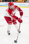 ADRIAN, MI - MARCH 18: Hannah Kiraly (21) of Plattsburgh State University controls the puck during the Division III Women's Ice Hockey Championship held at Arrington Ice Arena on March 19, 2017 in Adrian, Michigan. Plattsburgh State defeated Adrian 4-3 in overtime to repeat as national champions for the fourth consecutive year. by Tony Ding/NCAA Photos via Getty Images)