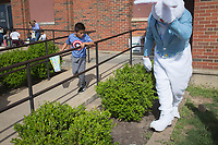 NWA Democrat-Gazette/CHARLIE KAIJO Jason Lopez, 10, searches for Easter eggs during an Easter egg hunt, Friday, April 12, 2019 at the Boys and Girls Club in Rogers. <br /> <br /> The Mitchell Williams Law Firm gave the Boys and Girls club of Rogers a $15,000 grant and held an egg hunt for the kids of the club. They offer grants each year through a program called Take Time To Give. The purpose is to encourage the law staff to do charitable work said Kyle Heffley, an attorney from the firm. <br /> <br /> The Boys and Girls club has five facilities in the county serving 150-200 kids at each site. The clubs experience a lot of wear-and-tear. Contributions from community organizations help the staff to focus on serving the kids.