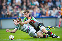 130712 Copyright onEdition 2012 ©.Free for editorial use image, please credit: onEdition..Sam Smith of Harlequins scores a try despite the efforts of Darren Allinson of London Irish at The Stoop, Twickenham in the first round of The J.P. Morgan Asset Management Premiership Rugby 7s Series...The J.P. Morgan Asset Management Premiership Rugby 7s Series kicked off again for the third season on Friday 13th July at The Stoop, Twickenham with Pool B being played at Edgeley Park, Stockport on Friday, 20th July, Pool C at Kingsholm Gloucester on Thursday, 26th July and the Final being played at The Recreation Ground, Bath on Friday 3rd August. The innovative tournament, which involves all 12 Premiership Rugby clubs, offers a fantastic platform for some of the country's finest young athletes to be exposed to the excitement, pressures and skills required to compete at an elite level...The 12 Premiership Rugby clubs are divided into three groups for the tournament, with the winner and runner up of each regional event going through to the Final. There are six games each evening, with each match consisting of two 7 minute halves with a 2 minute break at half time...For additional images please go to: http://www.w-w-i.com/jp_morgan_premiership_sevens/..For press contacts contact: Beth Begg at brandRapport on D: +44 (0)20 7932 5813 M: +44 (0)7900 88231 E: BBegg@brand-rapport.com..If you require a higher resolution image or you have any other onEdition photographic enquiries, please contact onEdition on 0845 900 2 900 or email info@onEdition.com.This image is copyright the onEdition 2012©..This image has been supplied by onEdition and must be credited onEdition. The author is asserting his full Moral rights in relation to the publication of this image. Rights for onward transmission of any image or file is not granted or implied. Changing or deleting Copyright information is illegal as specified in the Copyright, Design and Patents Act 1988. If you are in any way unsure of your rig