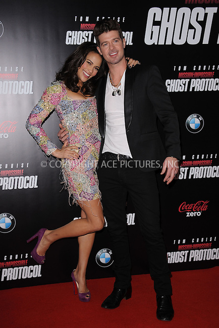 WWW.ACEPIXS.COM . . . . . December 19, 2011...New York City....Paula Patton and Robin Thicke attend the 'Mission: Impossible - Ghost Protocol' U.S. premiere at the Ziegfeld Theatre on December 19, 2011 in New York City....Please byline: KRISTIN CALLAHAN - ACEPIXS.COM.. . . . . . ..Ace Pictures, Inc: ..tel: (212) 243 8787 or (646) 769 0430..e-mail: info@acepixs.com..web: http://www.acepixs.com .