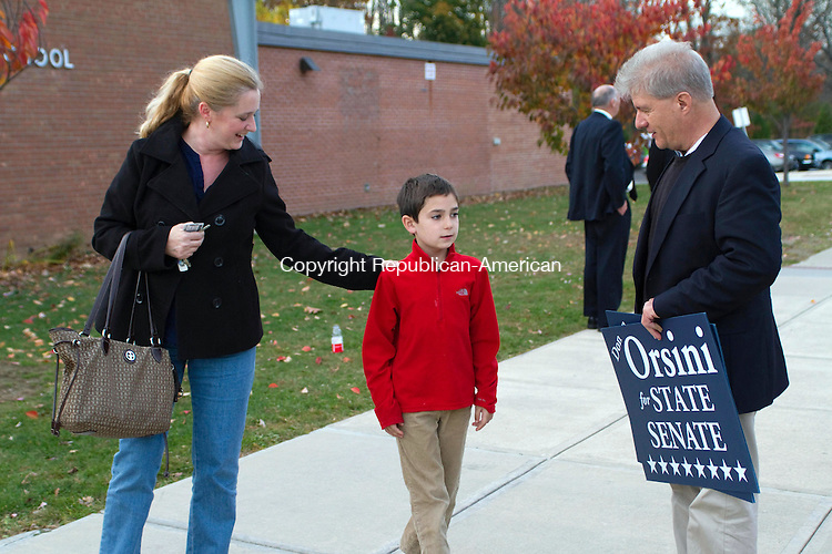 WATERTOWN, CT, 04 November 2014-110414LW10 - From left, Aimee Guerrera and her son, Julian Guerrera speak with Democratic candidate for the state's 32nd senate District Donato Orsini at Judson School in Watertown Tuesday. Laraine Weschler Republican-American