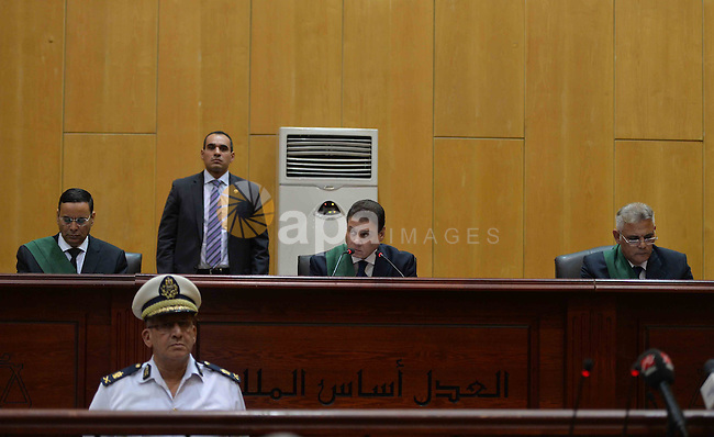 Egyptian Judge Mohammed Sheren Fahmi speaks during the trial of ousted Egyptian president Mohammed Morsi in a court in Cairo on August 27, 2015. Cairo criminal court resumes today the trial of deposed president Mohamed Morsi and 10 others on charges of espionage and leaking classified documents related to the national security and the army to Qatar.. Photo by Amr Sayed