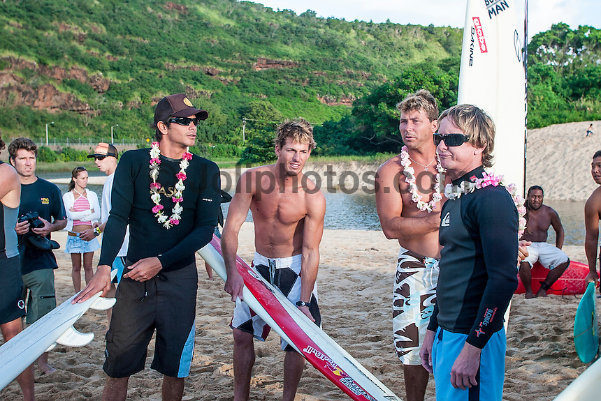Waimea Bay, North Shore, Oahu, Hawaii December 15 2004.<br /> Myles Padaca, (HAW), Andy Irons (HAW), Pancho Sullivan (HAW) and Noah Johnson (HAW) -The 2004 Quiksilver Eddie Aikau Big Wave Invitational won by Hawaiian surfer Bruce Irons (HAW) from the island of Kauai was held in 30 to 40' waves at Waimea Bay on the North Shore of Oahu Hawaii, today, December 15th 2004. Irons rode one of the biggest waves of the day which was at least 30' in height, taking home US$55,000 in prize money.  Photo: Joliphotos.com