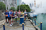 Leicester City's Elliott Moore fires the Noon Day Gun while (from left to right) Hong Kong Football Club's Gary Gheczy , Aston Villa's Khalid Abdo, West Ham United's Lewis Page, Stoke City's Lewis Banks, Wellington Phoenix's Justin Gulley, and Newcastle United's Dan Barlaser watch, to celebrate the launch of the HKFC Citi Soccer Sevens on 19 May 2016 in Causeway Bay, Hong Kong, China. Photo by Lucas Schifres / Power Sport Images