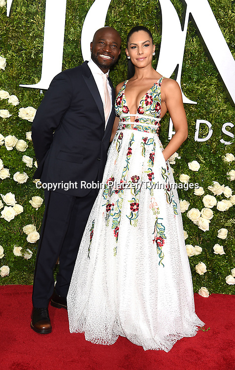 Taye Diggs and Amanza Smith Brown attend the 71st Annual  Tony Awards on June 11, 2017 at Radio City Music Hall in New York, New York, USA.<br /> <br /> photo by Robin Platzer/Twin Images<br />  <br /> phone number 212-935-0770