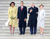 Washington, DC - January 20, 2009 -- (L-R) Michelle Obama, United States President Barack Obama, Former President George W. Bush and Laura Bushwait to wave goodbye as former Vice President Dick Cheney departs on the East Front of the US Capitol Building after Barack Obama was sworn in as the 44th President of the United States in Washington, DC, USA 20 January 2009.  Obama defeated Republican candidate John McCain on Election Day 04 November 2008 to become the next U.S. President..Credit: Tannen Maury - Pool via CNP