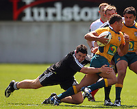 Jeff Allen tackles Mark Swanepoel during the International rugby match between New Zealand Secondary Schools and Suncorp Australia Secondary Schools at Yarrows Stadium, New Plymouth, New Zealand on Friday, 10 October 2008. Photo: Dave Lintott / lintottphoto.co.nz