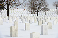 Grave markers at Fort Snelling National Cemetery during winter.