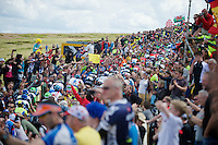 peloton sheered up Holme Moss Hill (521m/4.7km/7%) by the massive Brit crowds<br /> <br /> 2014 Tour de France<br /> stage 2: York-Sheffield (201km)