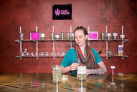 Budtender Erica Davis (cq) sorts marijuana at Pink House, a marijuana dispensary in Denver, Colorado, Sunday, January 26, 2013. <br /> <br /> Photo by Matt Nager
