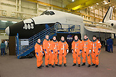 Houston, TX - December 19, 2007 -- The STS-123 crewmembers take a break from a training session to pose for a photo in the Space Vehicle Mockup Facility at the Johnson Space Center in Houston, Texas on December 19, 2007. From the left are astronauts Garrett E. Reisman, Richard M. Linnehan and Robert L. Behnken, all mission specialists; Gregory H. Johnson, pilot; Dominic L. Gorie, commander; Michael J. Foreman and Japan Aerospace Exploration Agency's (JAXA) Takao Doi, both mission specialists. The crewmembers are attired in training versions of their shuttle launch and entry suits. Reisman is scheduled to join Expedition 16 as flight engineer after launching to the station on mission STS-123.  STS-123, flying aboard the Space Shuttle Endeavour, is scheduled for launch at 2:28 a.m. EDT Tuesday, March 11, 2008.  Its mission is to deliver the first pressurized component of the Japanese Kibo (Hope) Laboratory and a Canadian robotic device called Dextre utilizing 5 spacewalks.  Its 16-day flight is the longest shuttle mission to date..Credit: NASA via CNP