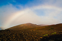 A rainbow seen in the crater of HALEAKALA NATIONAL PARK on Maui in Hawaii at sunrise