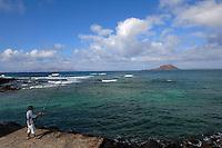Fishing from Corralejo harbour Fuerteventura, showing Isla de Lobos with Lanzarote on the left. Fuerteventura, Canary Islands,Spain.