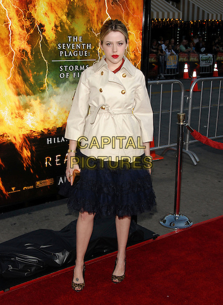 "MAJANDRA DELFINO .The Warner Brothers' Pictures L.A. Premiere of ""The Reaping"" held at The Mann Village Theatre in Westwood, California, USA..March 29th, 2007.full length black dress skirt tattoo foot leopard print shoes beige mac trenchcoat .CAP/DVS.©Debbie VanStory/Capital Pictures"