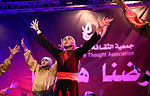 """Palestinian youths perform a traditional dance during a festival titled """"our land..our identity"""" marking the Land day in Gaza city on March 29, 2017. Photo by Ashraf Amra"""