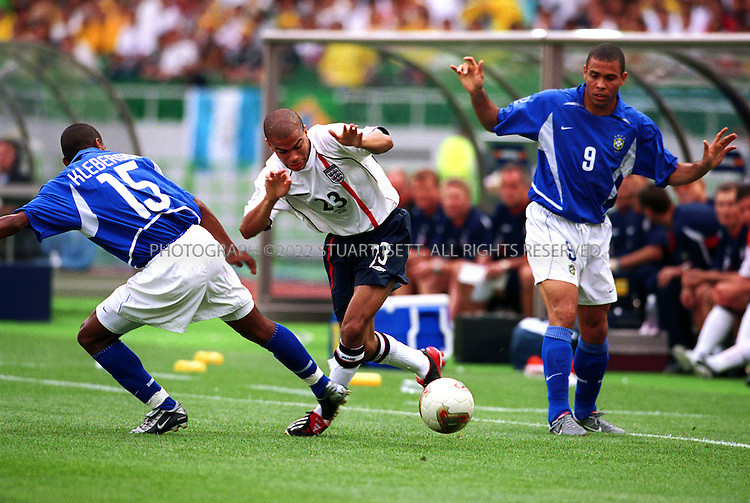6/21/2002--Shizuoka, Japan..England's Kieron Dyer seems afraid of the ball in 9 th  minute of the second half. England lost 2-1 to Brazil in the 2002 World Cup quarterfinal soccer match Friday, June 21, 2002, in Shizuoka, Japan. ...All photographs ©2003 Stuart Isett.All rights reserved.This image may not be reproduced without expressed written permission from Stuart Isett.