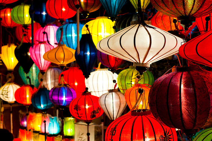 Chinese Lanterns at the Full Moon Festival at Hoi An, Vietnam. On the 14th day of every Lunar month, the Unesco World Heritage Site of Hoi An has a full moon festival. Electricity is switched off and the town is lit by candle light and chinese lanterns. It is a fantastic spectacle, which based on the unbelievable busyness, it would appear the entire town come out to enjoy. The excitable atmosphere, traditional games of Bai Choi (like Bingo) and endless enormous chinese lanterns make for a brillant evening. As the full moon celebrations continue long into the night, the Thu Bon River and harbour area of Hoi An become a flowing river of candles, which people release in order to bring good luck. If you are travelling to Vietnam, it is definitely worth trying to coincide your stay at Hoi An with the full moon festival.