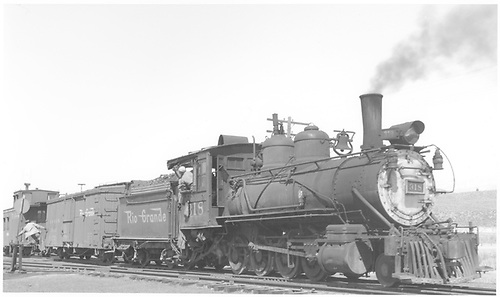 3/4 engineer's-side view of D&amp;RGW #318 switching at Ridgway.<br /> D&amp;RGW  Ridgway, CO  Taken by Peyton, Ernie S. - 3/30/1950