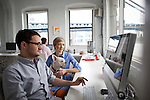 BROOKLYN -- APRIL 22, 2011: Josh Stewart (L) and Jessi Arrington holding Pinky (R) at work at Studiomates on April 22, 2011 in Dumbo, Brooklyn.   (PHOTOGRAPH BY MICHAEL NAGLE)