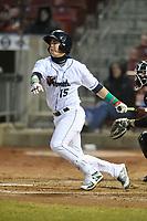 Cedar Rapids Kernels second baseman Jose Miranda (15) swings at a pitch against the Clinton LumberKings at Veterans Memorial Stadium on April 13, 2018 in Cedar Rapids, Iowa. Clinton won 2-0.  (Dennis Hubbard/Four Seam Images)