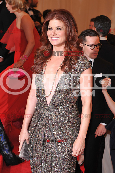 Debra Messing at the 'Schiaparelli And Prada: Impossible Conversations' Costume Institute Gala at the Metropolitan Museum of Art on May 7, 2012 in New York City. © mpi03/MediaPunch Inc.