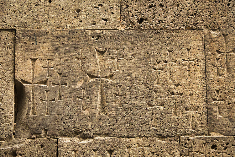 ancient carved crosses on walls of medieval Tatev Monastery in Armenia