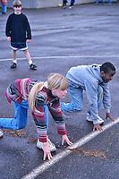 Two students racing on playground of elementary school. Corvallis, Oregon